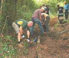 Marwell Zoo staff and Southern Scottish Energy Corporate Volunteers add a drainage system to the renovated bridleway