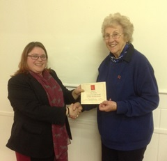 County Chairman Johanna Searle presents Pam Human with her 10 year long service award