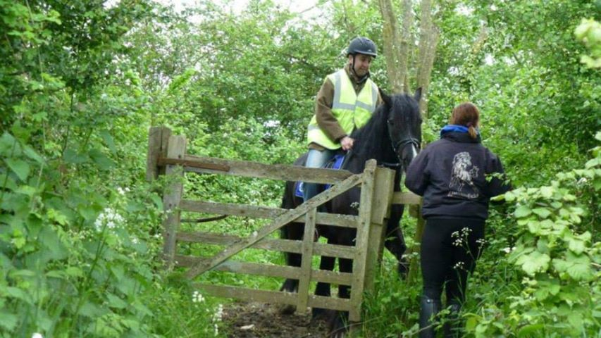 An Oxfordshire Countryside Access Team member learning the difficulties of bridleway gates