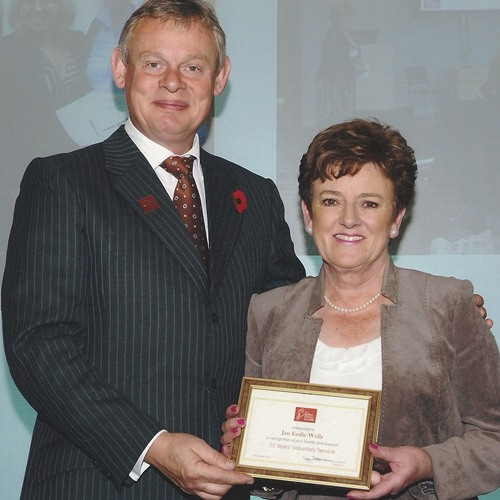 Jan Eedle-Wells receiving a 25 year long-service award from BHS President Martin Clunes