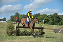 Hugh Train horse jumping cross country fence
