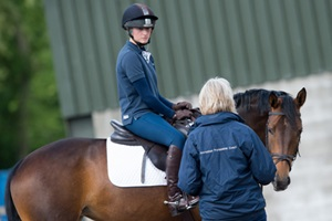 Sabrina Jones BHS Accredited Professional Coach teaching rider during riding lesson